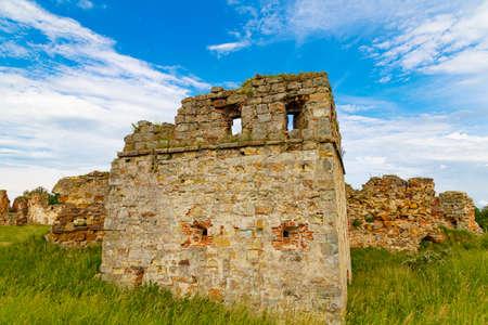 Medieval abandoned Pniv castle, Nadvirna city, Ivano-Frankivsk region, western Ukraine. Wall of fortress on sky background.