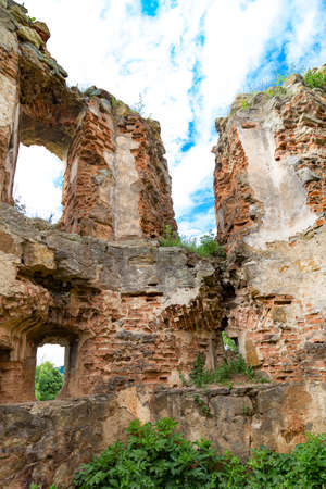 Scenic ruins on medieval abandoned Pniv castle on cloudy sky background. Nadvirna city, Ivano-Frankivsk region, western Ukraine. Ruined fortress.