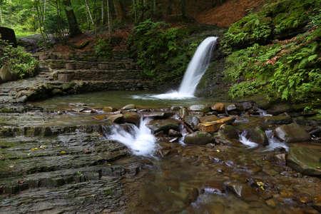 Nature landscape with beautiful cascade waterfall Krutylo in mountain gorge on Turichka river near Lumshory village of TransCarpathia, Carpathians. Ukraine. Standard-Bild