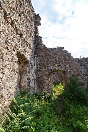 Scenic ruins of medieval Nevytsky (Nevytske) castle inside. Transcarpathian region. Ukraine. Tourism destination, tourist landmark.