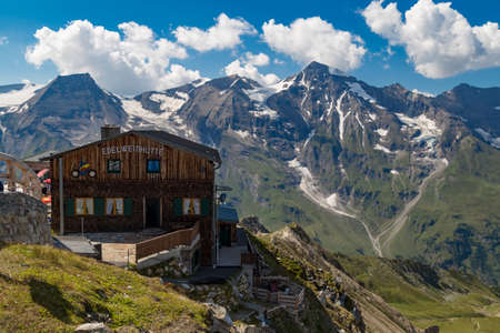 04.08.2018. Mountain shelter on a background of snowy peaks at summer. Grossglockner High Alpine Road. Austria. Tyrol. Europe.
