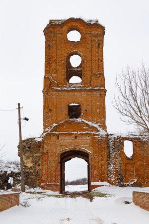 Ruins of old abandoned Korets Castle in the snow. Tower. Koretsk city. Rivne region. Ukraine. Tourist attraction.