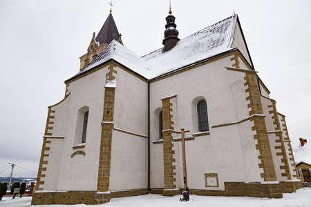 Old historical parish Church of the Visitation of the Most Blessed Virgin Mary outdoors. Lesko (Lisko) town. Poland. Subcarpathian Voivodeship.