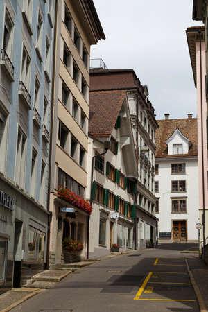 08/17/2019 Street with old houses of village Einsiedeln, main religious pilgrimage center in Switzerland. Canton of Schwyz. Tourist destination. Standard-Bild