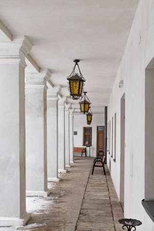 White portico, decorated lanterns. Ancient castle in town Lesko (Kmita family castle). Poland.