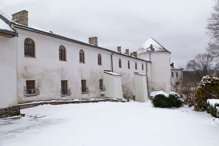 Ancient castle in town Lesko town. (Kmita family castle) outside, at winter snowy day. Poland.