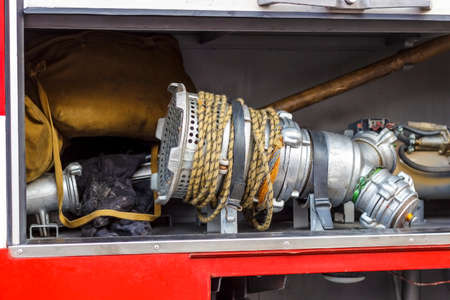The fire truck is red. Fire and rescue equipment in a fire truck. Banque d'images - 130657118