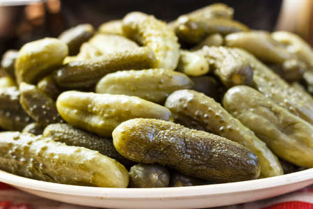 Close-up of pickled green cucumbers with dill and spices Stock Photo