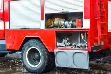 The fire truck is red. Fire and rescue equipment in a fire truck. Stockfoto