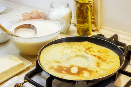 The process of making pancakes in the background milk, eggs, sugar, salt, flour, vegetable oil.