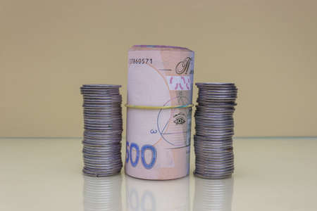 Euro dollars money. Euro coins are dollars. Euro-dollar currency. The concept of money. Bills are stacked on each other in different positions with coins. Imagens