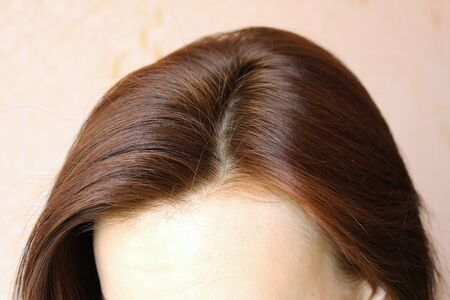 Women's hair is a top view close-up. Stock Photo