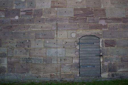 Wooden door in an old wall