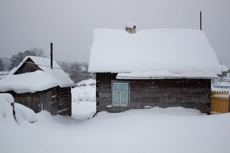 Remote log cabin in untouched snow