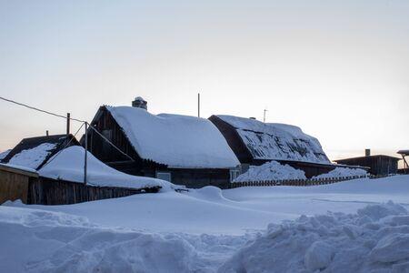 Wooden house in winter. Winter landscape. Winter in Siberia.