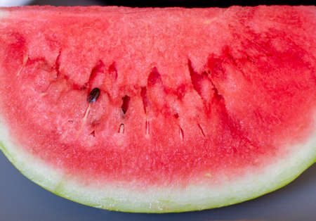 Tasty sliced watermelon on table outdoors. Red juicy sliced watermelon