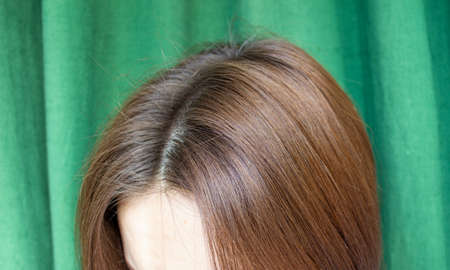 Women's hair after washing on a green background. the view from the top.