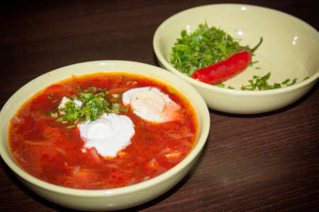 A spicy tomato soup with chili pepper on the background of a wooden table Stock Photo