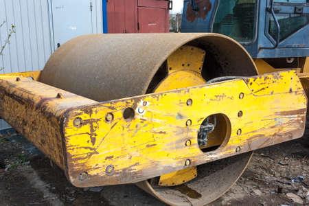 Old asphalt machine roller close-up after work