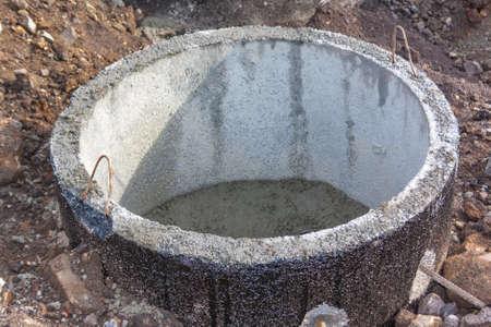 Concrete shaft manhole rings on a building site