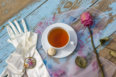 Cup of tea on plate on wooden rustic background
