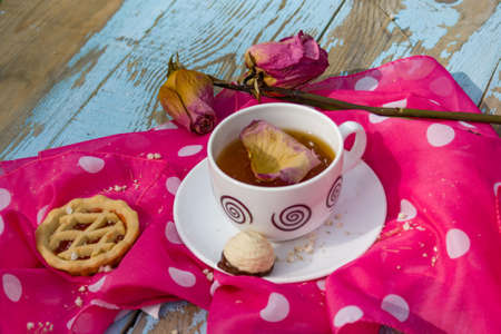 favorite soup: Still life a cup of black tea cake and a rose