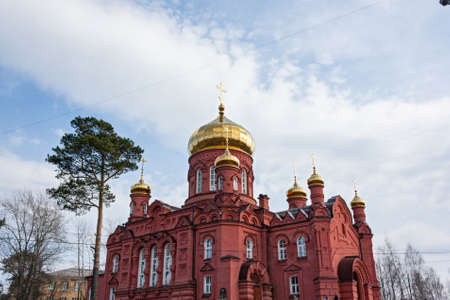 the old building of the Russian Orthodox Church in the city of Nizhny Tagil , red brick against the blue sky