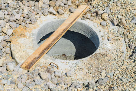 Concrete construction tube pipe. Building a road sewer drain system