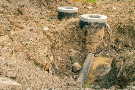 culvert: Concrete construction tube pipe. Building a road sewer drain system