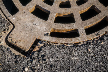 castings: A round grille sewage wells to drain rain and melt water Stock Photo