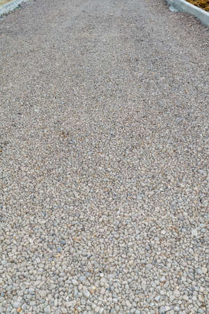 Prepared foundation of crushed stone for paving road asphalt