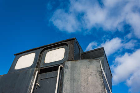 Ancient steam locomotive front view on sky background