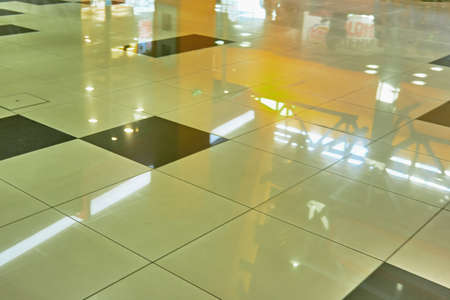Reflection in the polished floor tile of a large shopping center Stock fotó
