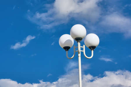 Street lamp against a blue sky close-up Stock Photo