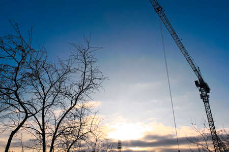 Beautiful sunset with tower crane work site