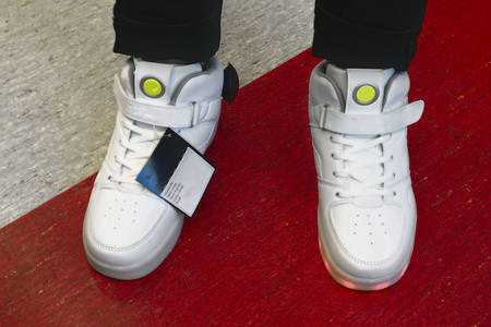 Sports shoes for skateboarding with LED backlight