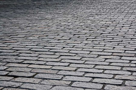 Roadway made of natural stone texture close-up