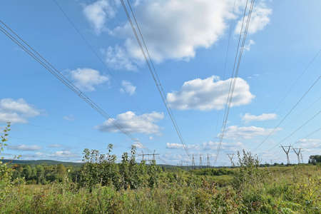 Power line support against the clear blue sky.