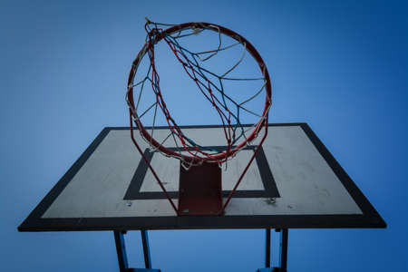 Basketball basket on blue sky background. Basketball basket and board on the blue sky background. Basketball hoop and backboard against blue sky Stock Photo