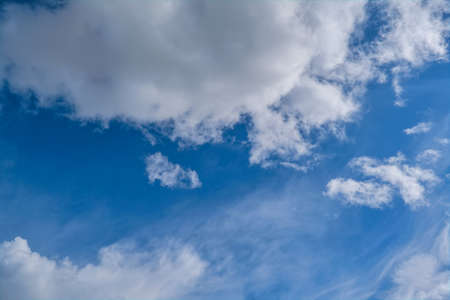 Blue summer sky white cumulus clouds background.