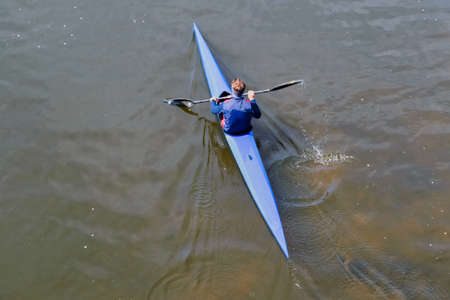 Aerial Top View of Man Kayaking on river, young man rowing in kayak down the river.