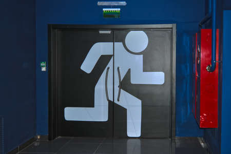 Run to Exit. Emergency exit with a wild man running man in the shopping and entertainment center.