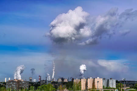 Large industrial metallurgical plant on a cloudy day. Pollution of the environment by a metallurgical plant. Фото со стока