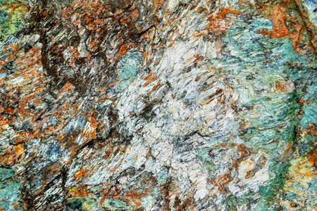 Natural Surface texture of serpentinite. Background with green mineral rock close up, gemstone texture. Stock Photo