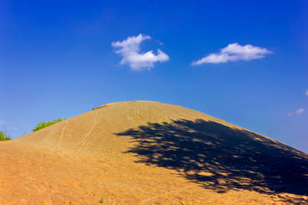 Low angle view of giant sand dune against the sky.