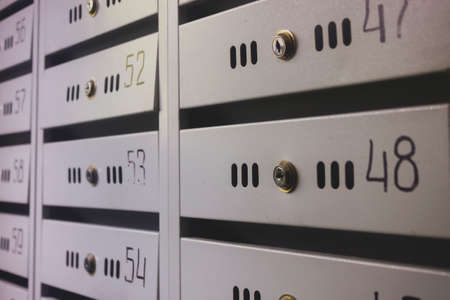 Mailboxes in an apartment house close-up. Stock Photo