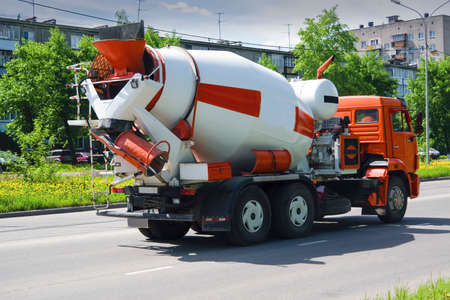 Mixer truck is transporting cement to the casting place.