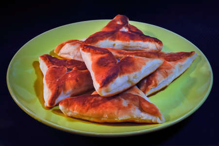 A traditional dish of Russian, Bashkir and Tatar cuisine. It is a pie fried in butter from fresh or yeast dough with minced meat or finely chopped meat.
