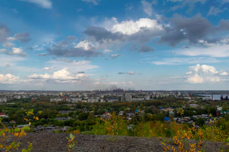 View of the city and the metallurgical plant from the top of the mountain summer landscape. Nizhny Tagil, Sverdlovsk region, Russian Federation.