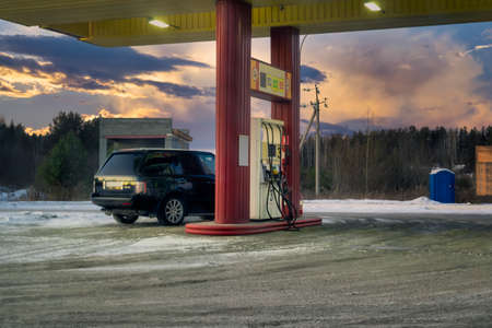 Gas station at sunset. Gas station. Petrol pump in gas station. Filling the column with different fuels at the gas station. Reklamní fotografie